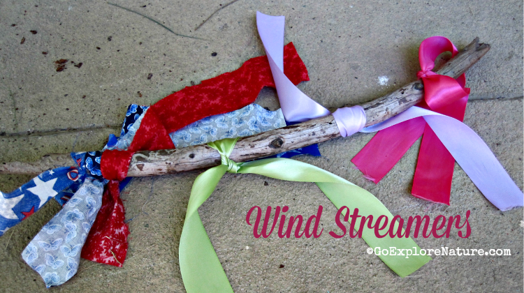 To make magical fairy wind streamers of your own, all you need are a few strips of old material and a stick and you're ready to go. No wind required!
